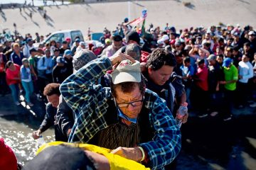 Photo of migrants crossing the river at the US-Mexico border