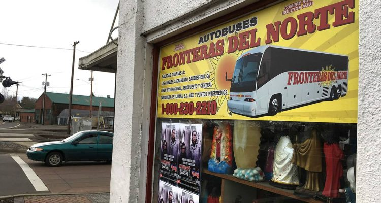 Photo of sign advertising bus trips to California with connections to Mexico