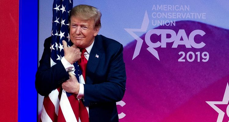 Photo of President Donald Trump hugging an American flag