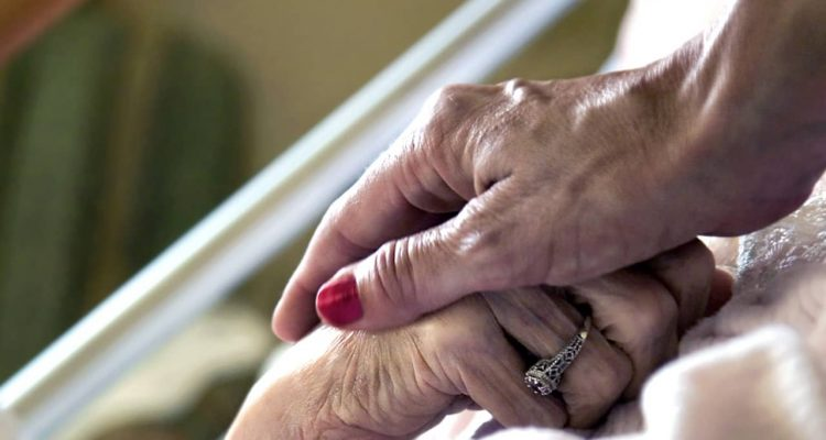 Hand in hand symbolizing hospice care
