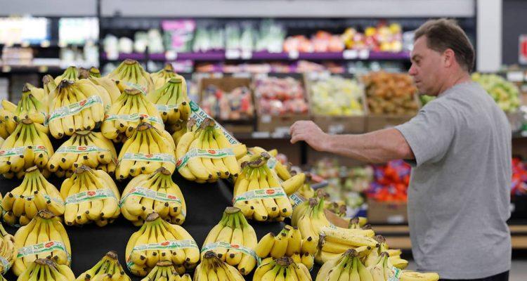 Photo of consumer shopping for bananas