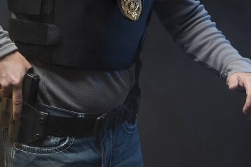 Photo of police officer holding a gun