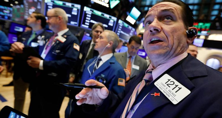 Photo of Tommy Kalikas with fellow traders on the floor of the NYSE