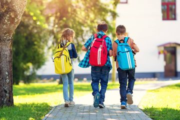 Photo of 3 children walking to school