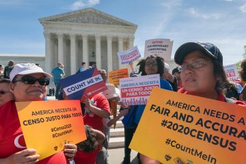 Protesters rally outside of U.S. Supreme Court as justices hear arguments on including a citizenship question in the 2020 census.