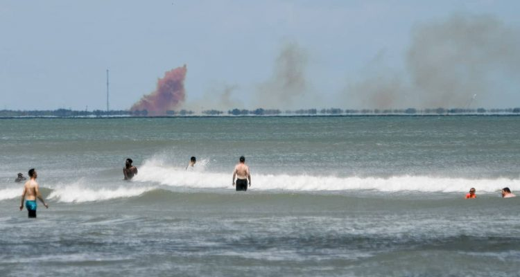 Photo of a cloud of smoke over the Cape Canaveral Air Force Station, seen from Cocoa Beach, Fla.