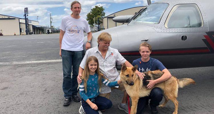 Photo of Chloe, Doug and Chase Peterson greeting their long-lost German Shepherd dog Cedar