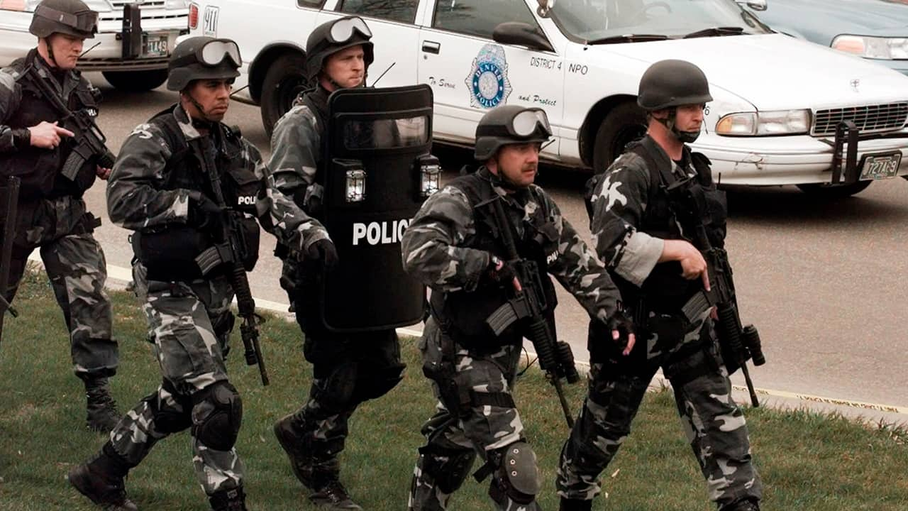 Photo of SWAT team marching into Columbine High School