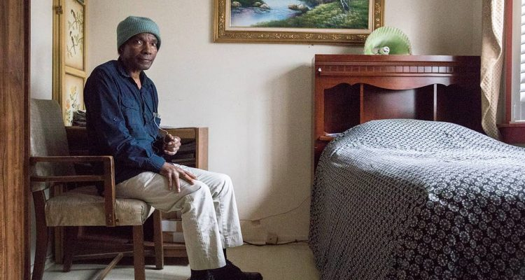 Photo of Tom Gray in his bedroom