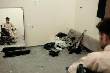 Photo of Anas al-Sarrari sitting in a wheelchair in Yemen
