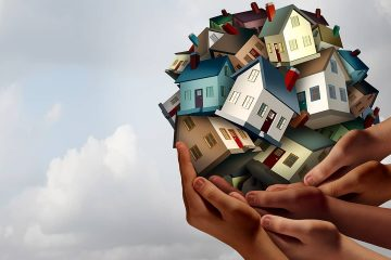 Composite of hands lifting up several toy houses. Image meant to convey affordable housing