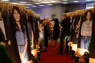Photos of Clovis Unified Students of Promise on display at scholarship dinner event.