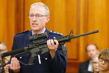 Photo of Mike McIlraith showing an AR-15 style rifle