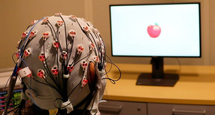 Pjhoto of a cap that administers electrical stimulation and monitors brainwaves