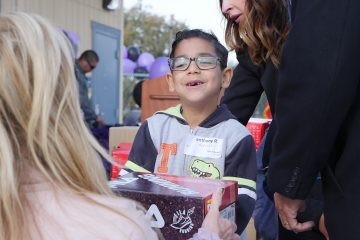 Photo of Tilley Elementary School student getting a new pair of tennis shoes from the nonprofit Shoes That Fit