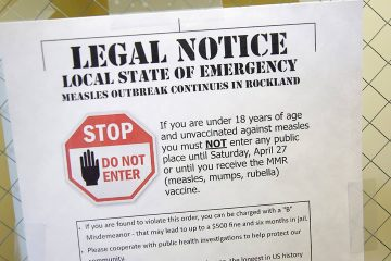 Photo of sign explaining the local state of emergency because of a measles outbreak