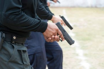Photo of police with guns
