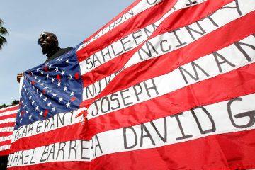 Photo of Malaki Seku holding an American flag