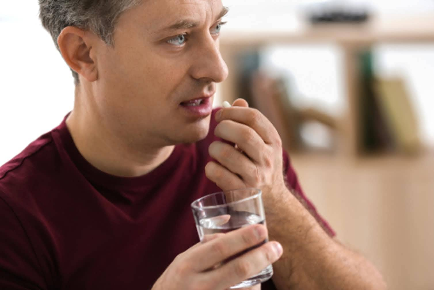 Photo of person taking antibiotics