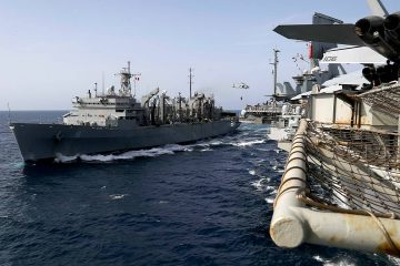 Photo of the fast combat support ship USNS Arctic transporting cargo