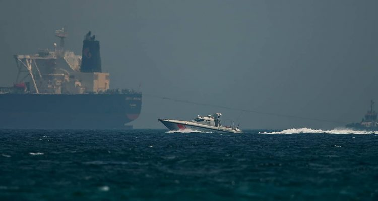 Photo of Emirati coast guard vessel passing an oil tanker