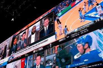 Photo of video screens in a betting lounge