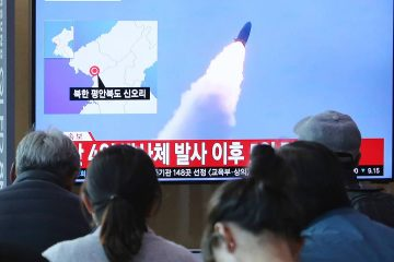 Photo of people watching North Korea's missile launch