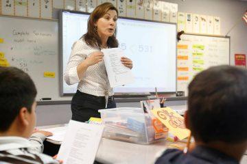 Photo of teacher going over a worksheet