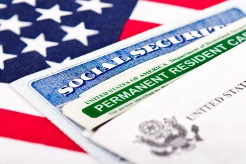 Composite of green card, social security card and American flag