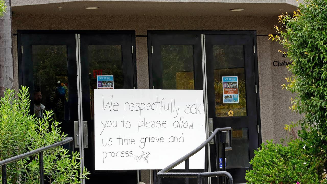 Photo of a sign outside of the Chabad of Poway synagogue
