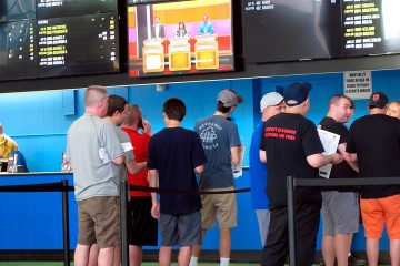 Photo of sports gamblers in line