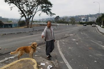 Photo of a man walking his dog in Venezuela