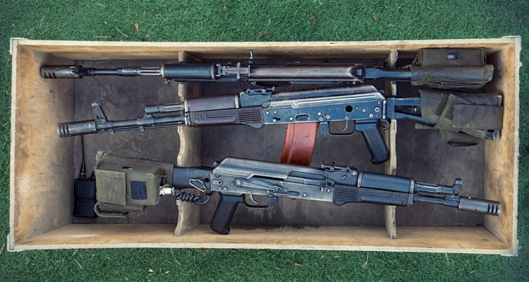 photo of three machine guns in a box