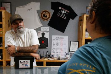 Photo of gun shop owner and customer
