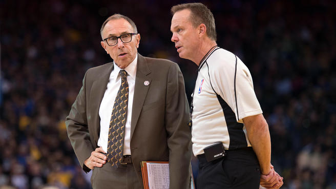 Photo of Golden State Warriors assistant coach Ron Adams and an NBA referee