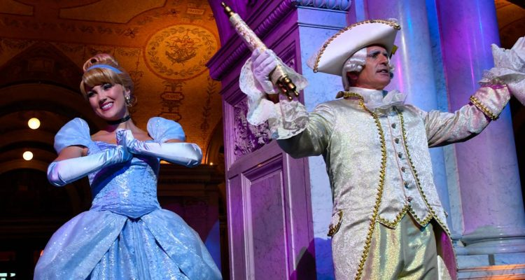 Photo of costumed Cinderella and Majordomo appear before guests
