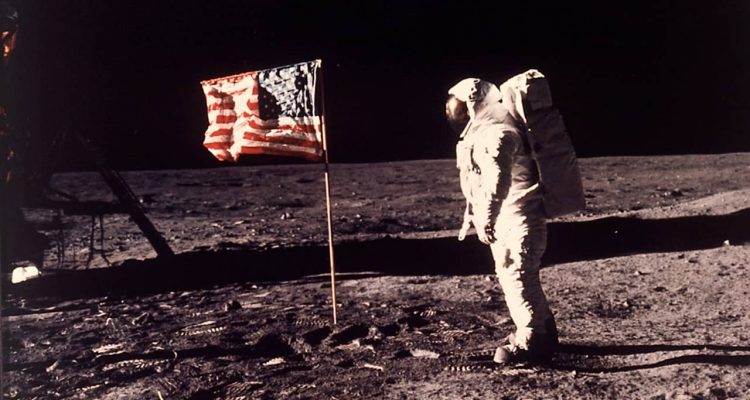 Photo of astronaut Buzz Aldrin posing for a photo beside the US flag on the moon