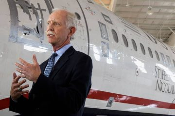 "Photo of Chelsey ""Sully"" Sullenberger talking to the media"