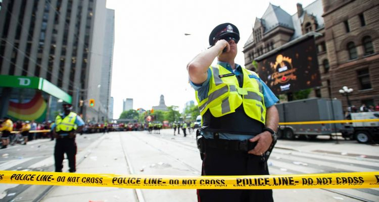 Photo of Toronto police securing the scene after shots were fired during the Raptors parade