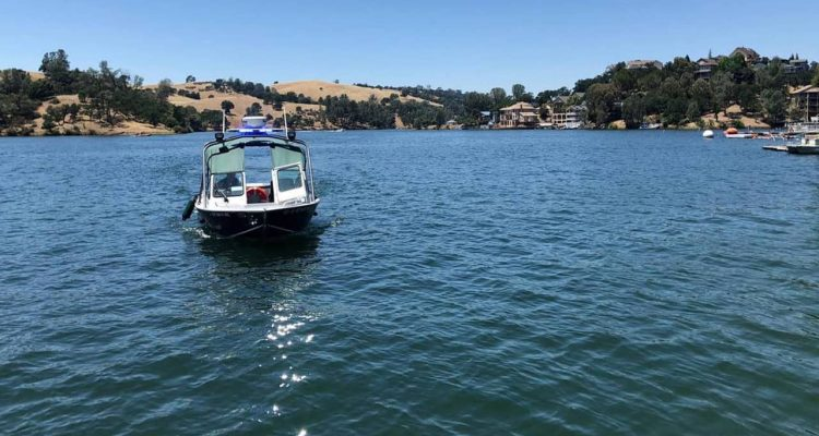 Photo of search boat looking for pilot and plane that sank at Lake Tulloch