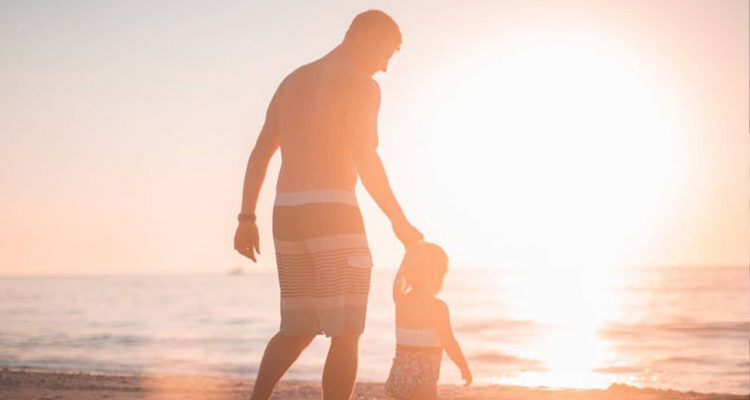 Photo of father and sun on the beach