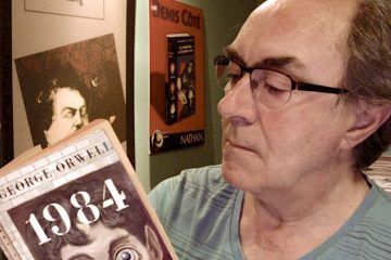 """Photo of a man reading """"1984"""""""