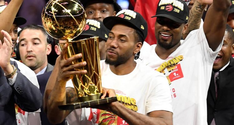 Photo of Kawhi Leonard holding the Larry O'Brien NBA Championship Trophy