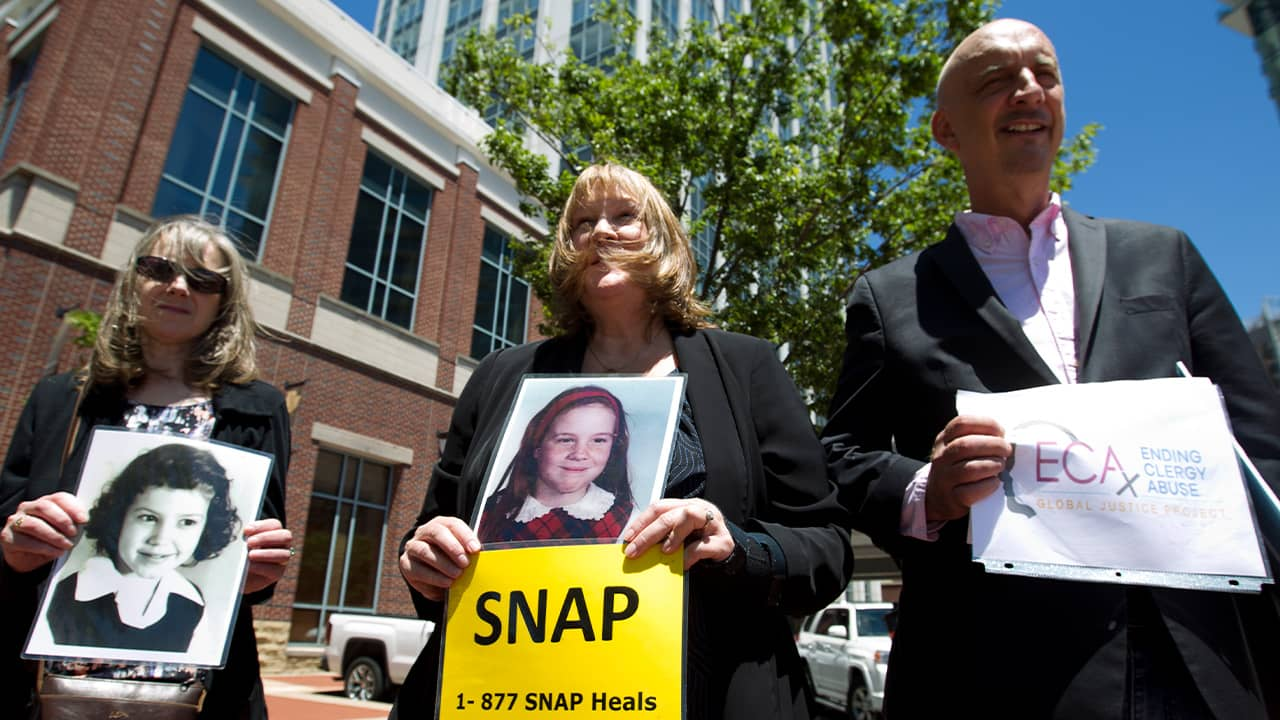 Photo of Becky Ianni, a victim of priest abuse, and other protestors