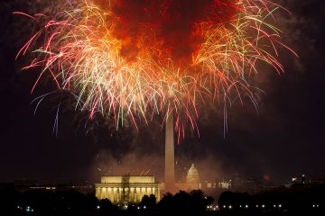 Photo of fireworks exploding over Lincoln Memorial, Washington Monument and U.S. Capitol