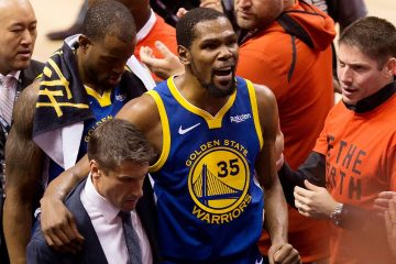 Photo of Kevin Durant reacting as he leaves the court after sustaining injury during Game 5