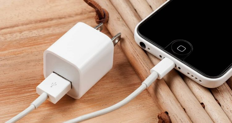 Photo of iPhone connected to a charger