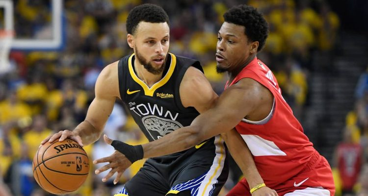 Photo of Golden State Warriors guard Stephen Curry and Toronto Raptors guard Kyle Lowry