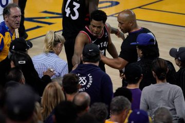 Photo of Kyle Lowry gesturing next to referee Marc Davis at Game 3 of the NBA Finals in Oakland, CA.
