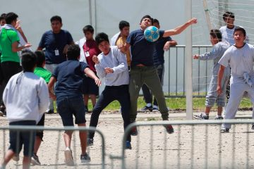 Photo of immigrant children playing soccer